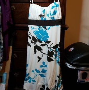 Very cute off white, brown,& teal dress Size S.